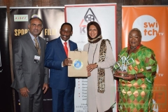 Ezekiel-Mutua-receives-a-gift-hamper-from-Nazneen-Karim-as-Aasif-Karim-and-Florence-Nduta-look-on