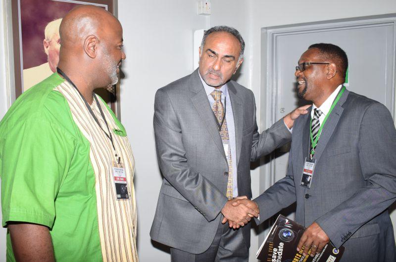 Aasif-Karim-acknowledges-the-presence-of-Larry-Ngala-as-Chris-Kamau-looks-on