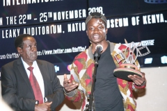 Benjamin-Rachar-makes-a-short-speech-after-receiving-the-trophy-for-best-short-documentary