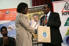 Sammy-Lui-hands-gift-hamper-to-Auma-Obama-after-the-future-role-of-sports-in-Kenya-and-Beyond-panel-session