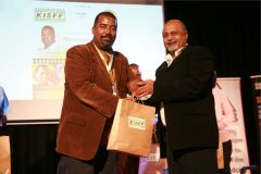 Eddy-Kimani-receives-a-gift-hamper-from-Mehboob-Nanji-after-the-panel-session-on-motorsport