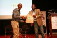 David-Thuo-receives-gift-hamper-from-Wilfred-Bungei-after-delivering-his-speech-on-recreational-running