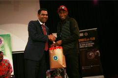 Extreme-sports-CEO-Hussein-Mohammed-recieves-a-gift-hamper-from-KISFF-Brand-ambassador-Douglas-Wakiihuri-after-the-panel-on-football-in-Kenya-4