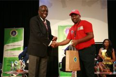 John-Ohaga-receives-gift-hamper-from-John-Muli-after-the-panel-session-on-sports-arbitration