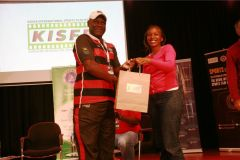 Edward-Rombo-receives-gift-hamper-from-Mary-Muriuki