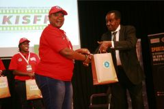 Florence-Nduta-receives-gift-hamper-from-Samy-Lui