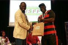 Wilfred-Bungei-receives-a-gift-hamper-from-Edward-Rombo-after-the-panel-session-on-future-of-sports-in-Kenya-at-the-global-stage