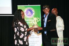 Kerubo Momany receives a trophy from Douglas Wakiihuri for the best short film Half Blood from France